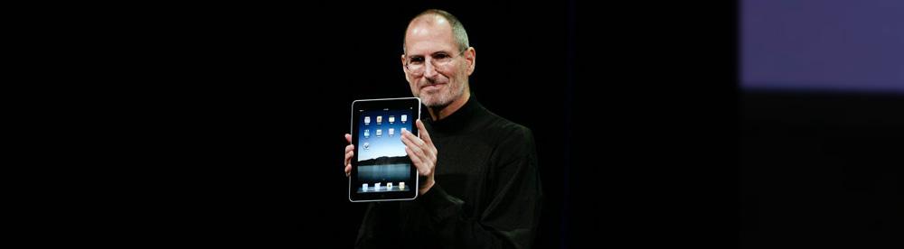 Steve Jobs holding iPad